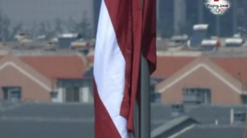 Latvijas karogs Pekinas olimpiskajās spēlēs 2008.gadā pēc M.Štromberga izcīnītās zelta medaļas BMX disciplīnā.