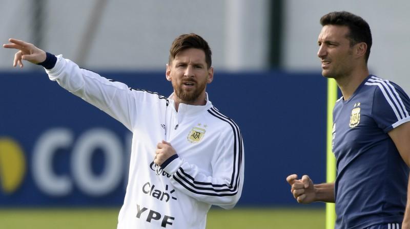 Lionels Mesi un Lionels Skaloni. Foto: AFP/Scanpix