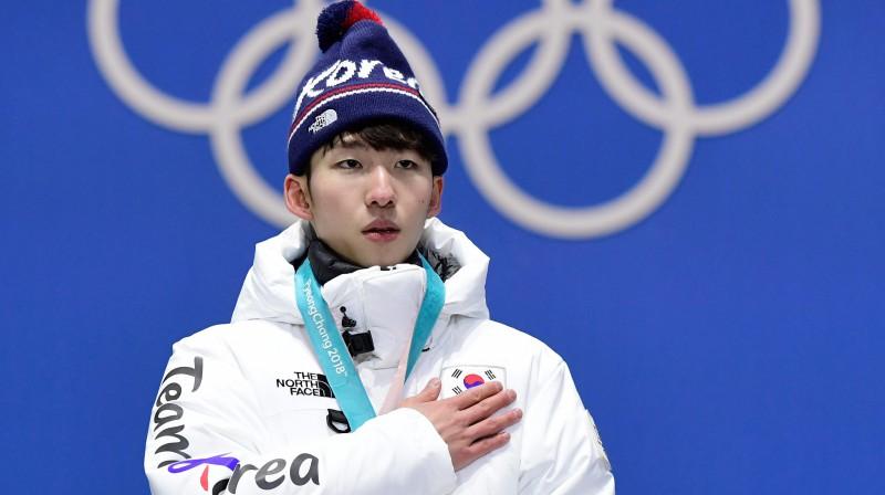 Hjodžuns Lims uz olimpiskā goda pjedestāla. Foto: AFP/Scanpix