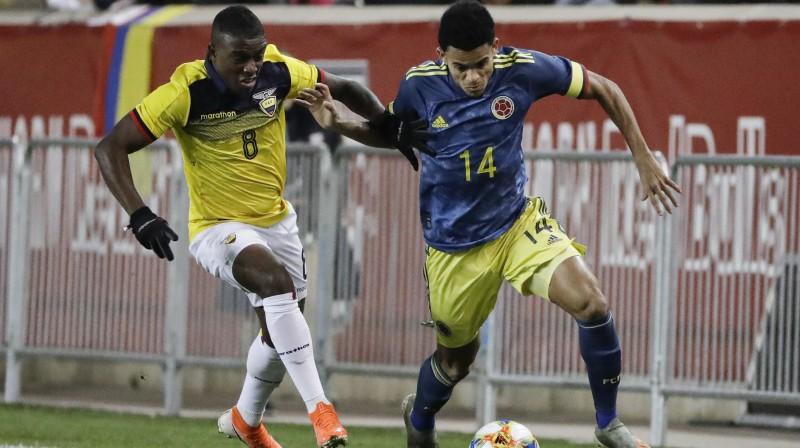 Cīņa starp Ekvadoras un Kolumbijas futbolistiem. Foto: Frank Franklin II/AP/Scanpix