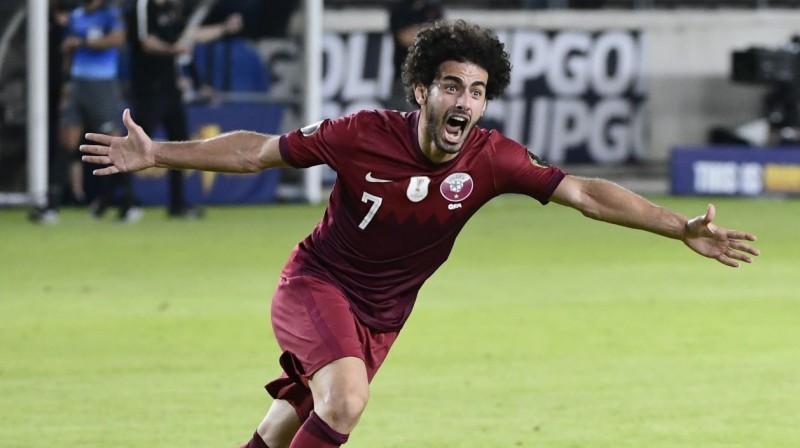 Kataras izlases futbolists Ahmeds Alāeldins svin vārtu guvumu. Foto: Justin Rex/AP/Scanpix